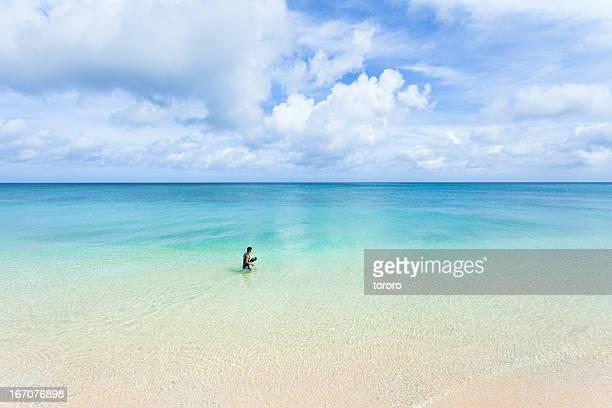 Walking in crystal clear water of tropical beach