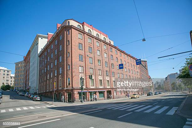 walking in front of old buildings at helsinki finland