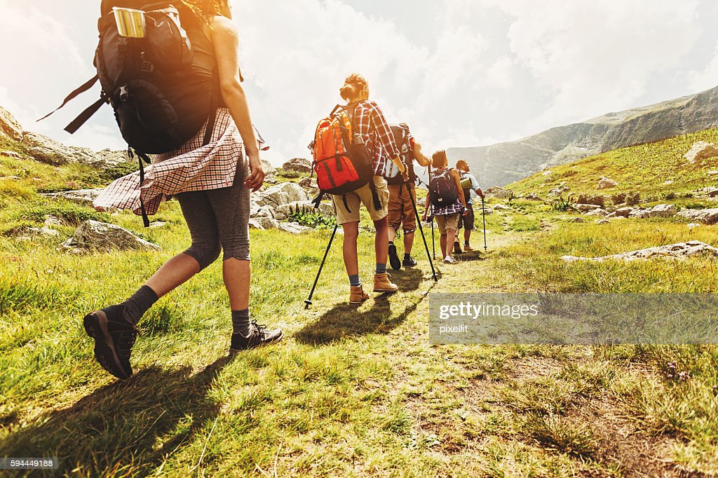 Walking in line in the mountain : Stock Photo