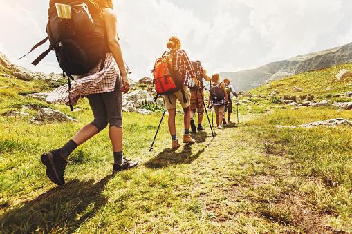 Walking in line in the mountain 594449188