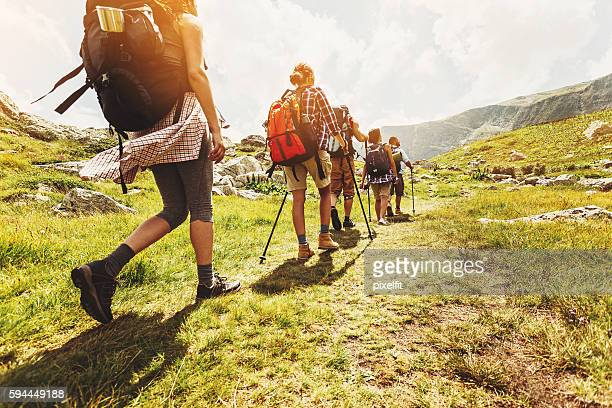 walking in line in the mountain - camping stock photos and pictures