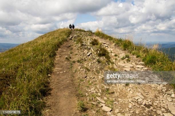 walking in mountains - maslowski stock-fotos und bilder