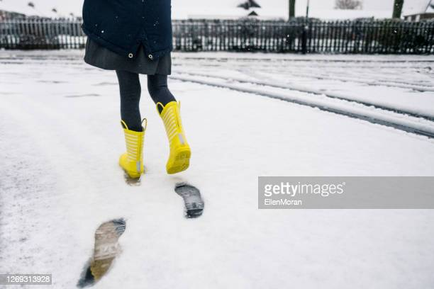 walking in the fresh snow - coat stock pictures, royalty-free photos & images