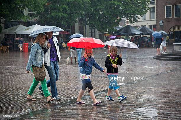 walking in the rain - deventer stock photos and pictures