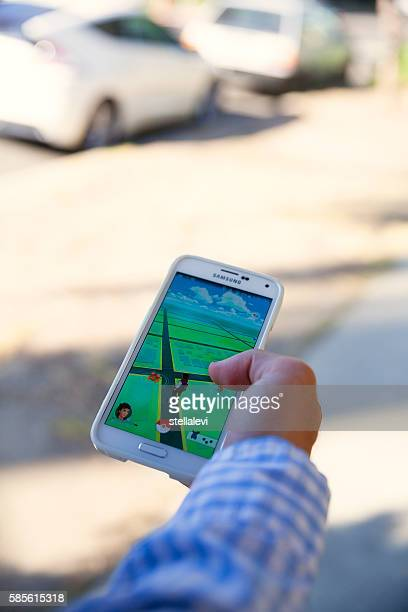 Walking in the street and playing Pokémon Go