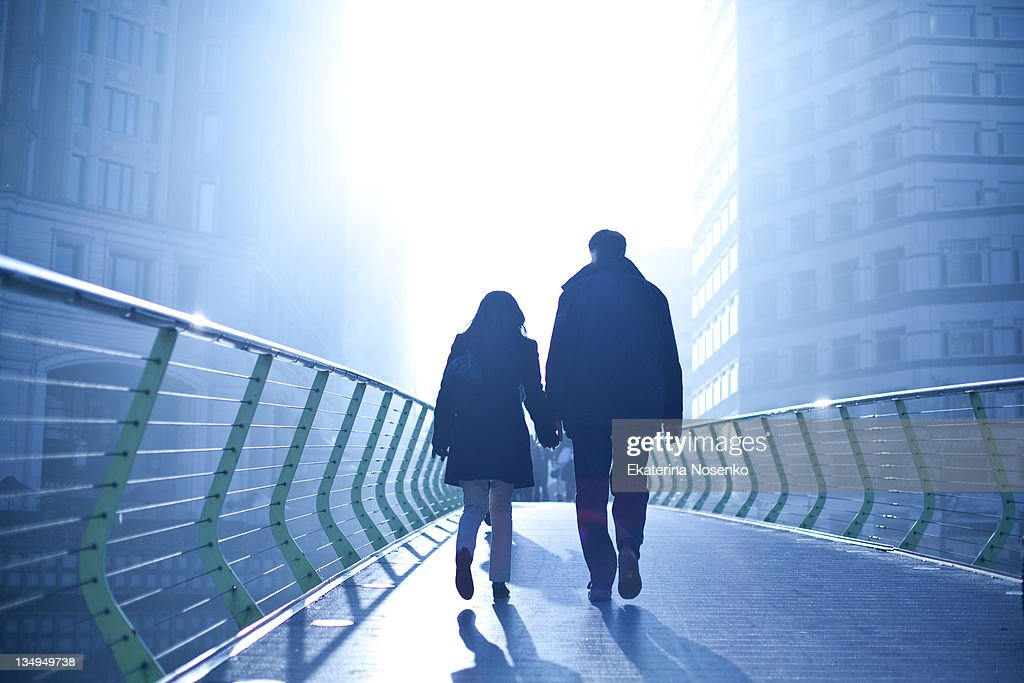 Walking into light : Stock Photo