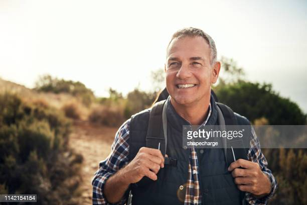 walking is a man's best medicine - one mature man only stock pictures, royalty-free photos & images