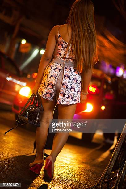 walking ladyboy and transgender on sukhumvit road - thailand prostitutes stock photos and pictures