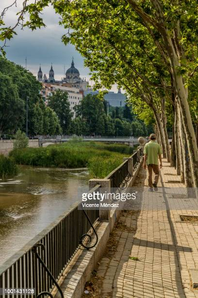 walking next to the river - royal cathedral stock pictures, royalty-free photos & images