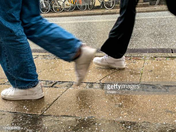 walking on a hailing street at copenhagen, denmark - vsojoy stock pictures, royalty-free photos & images