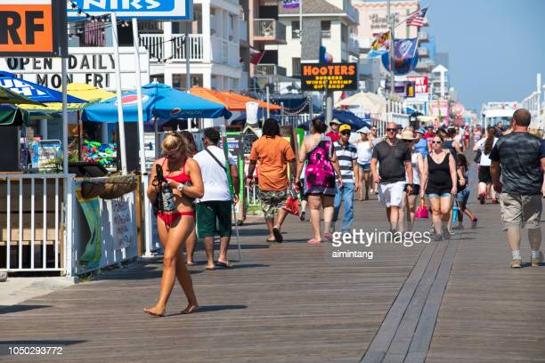 walking on boardwalk in ocean city - ocean city maryland stock pictures, royalty-free photos & images