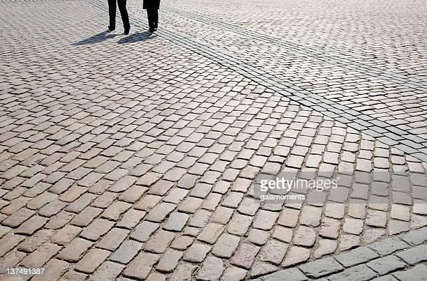 Walking On Cobblestone Square