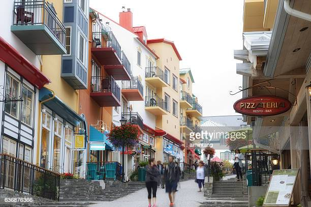 walking on cobblestone street in mont tremblant - mont tremblant stock pictures, royalty-free photos & images