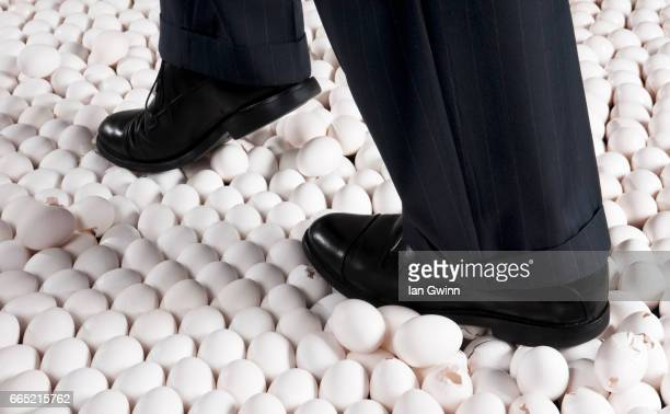 walking on eggshells - ian gwinn stock pictures, royalty-free photos & images