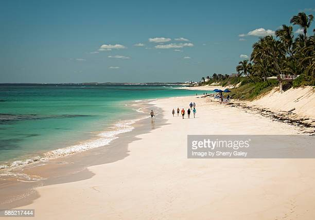 walking on elbow cay beach, bahamas - abaco islands stock photos and pictures