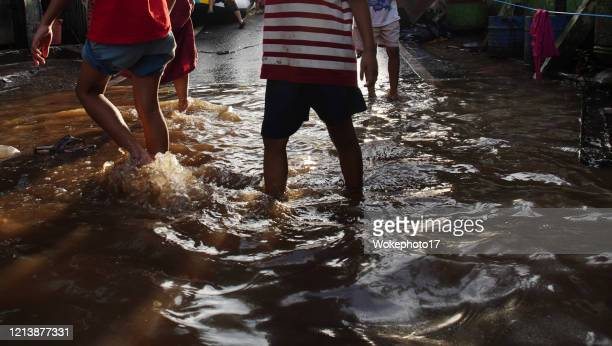 walking on flood - world water day stock pictures, royalty-free photos & images