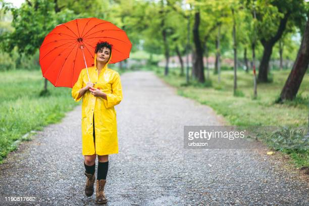 walking on rain - september stock pictures, royalty-free photos & images