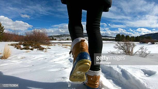 walking on snow with winter boots - 靴底 ストックフォトと画像