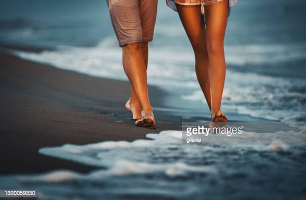 walking on the beach. - human foot stock pictures, royalty-free photos & images
