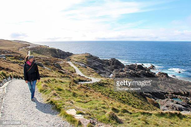 Walking on the coastal path of Malin Head, Ireland