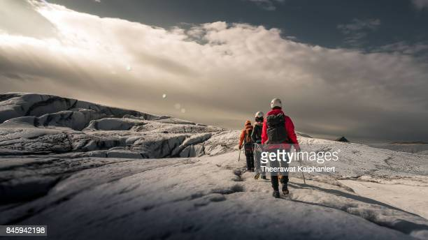 walking on the glacier, iceland - guidance stock pictures, royalty-free photos & images