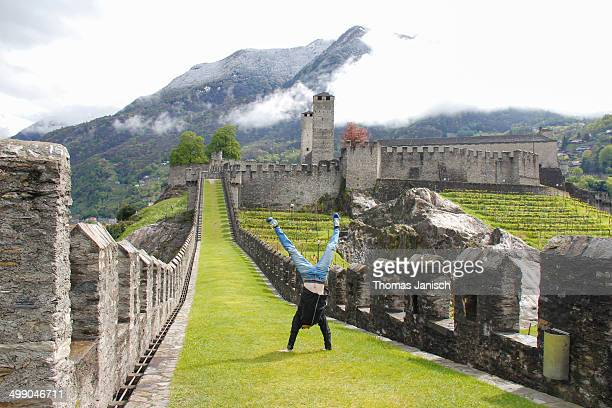 Walking on the green lawn rampart of ancient castle Castelgrande in Bellinzona, Ticino, Switzerland