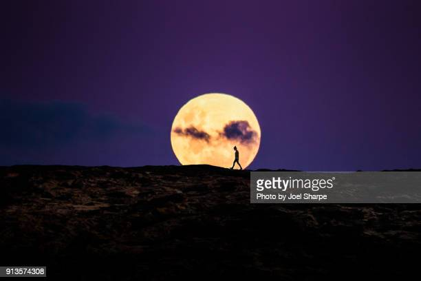 walking on the moon - supermoon stock pictures, royalty-free photos & images