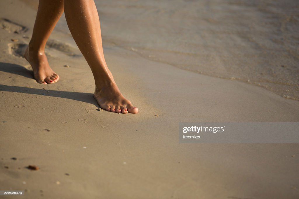 Walking on the sand : Stock Photo