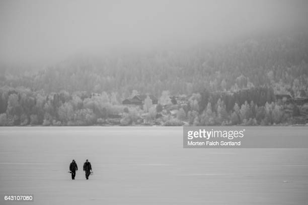 walking on thick ice - winter sports event stock pictures, royalty-free photos & images