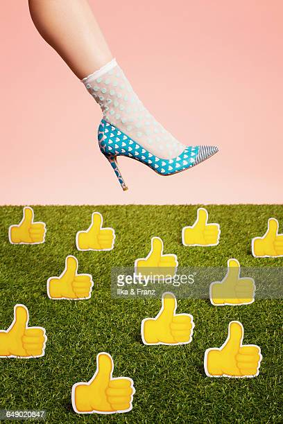 walking on thumbs-up - high heels stock pictures, royalty-free photos & images