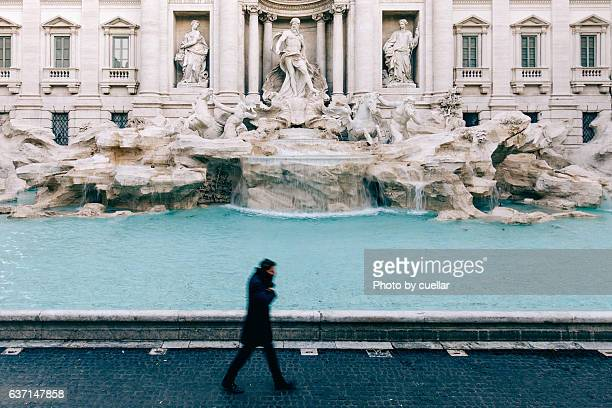 walking on trevi square - trevi fountain stock photos and pictures
