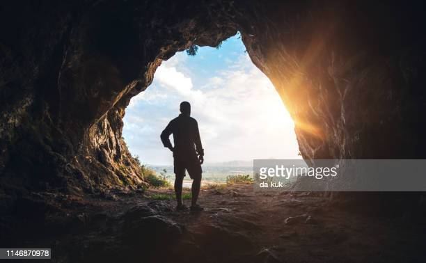 walking out of the cave - cave stock pictures, royalty-free photos & images