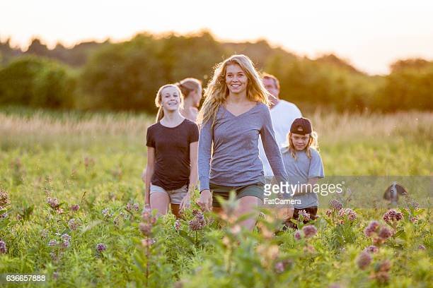 walking outside on a summer evening - fat hairy men stock photos and pictures