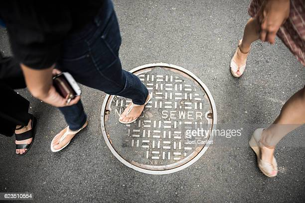 Walking over New York City sewer manhole cover