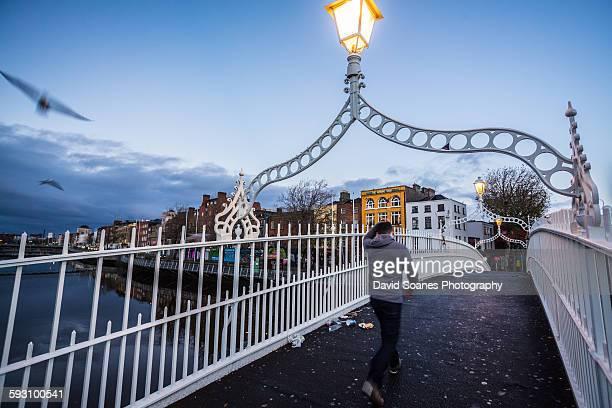 Walking over the Ha'penny Bridge, Dublin, Ireland