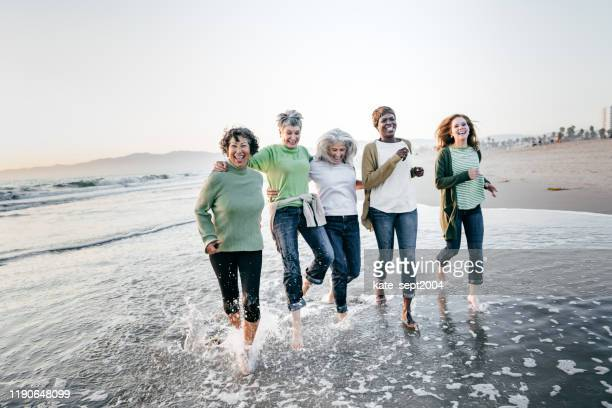 walking partners - five people stock pictures, royalty-free photos & images