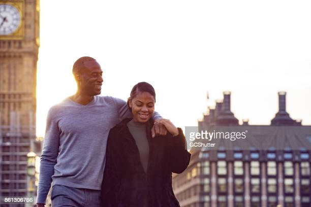 walking past big ben with a girlfriend - arm around stock pictures, royalty-free photos & images
