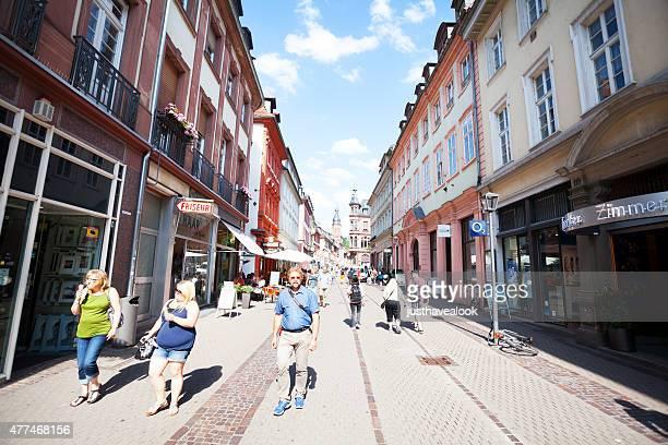 walking people in pedestrian zone hauptstraße heidelberg - hauptstraße stock pictures, royalty-free photos & images