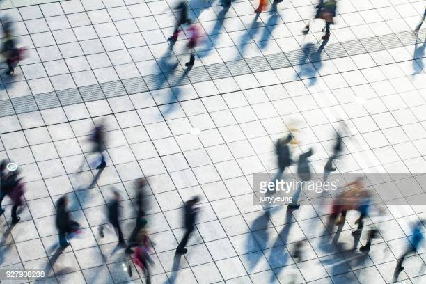 walking people - blurred motion stock pictures, royalty-free photos & images