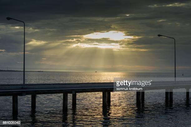 Walking sea bridge with golden sunlight in morning