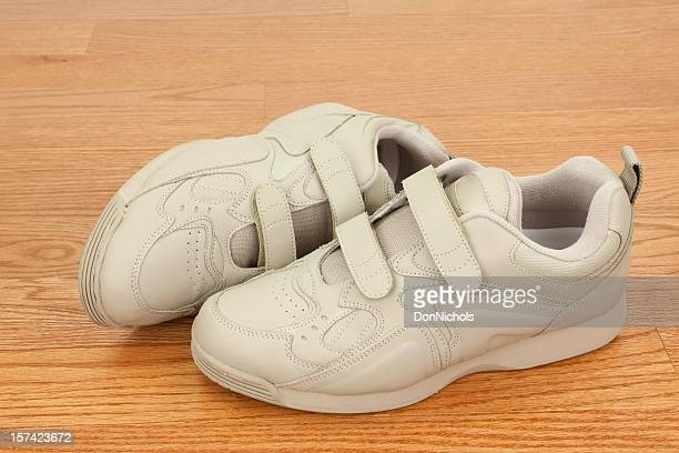 walking shoes on wood floor - nylon fastening tape stock photos and pictures