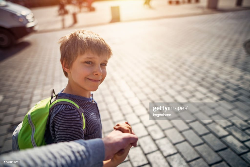 Walking son to school : Stock Photo