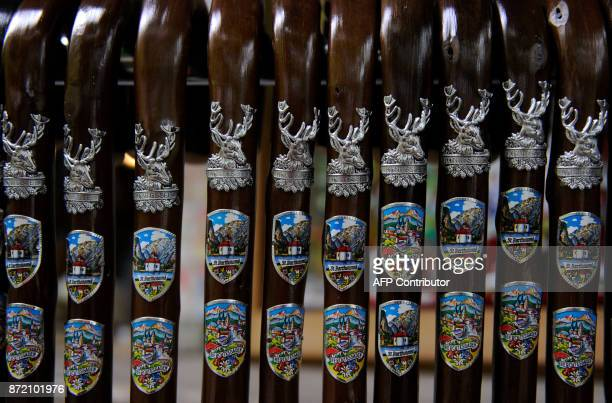 Walking sticks for sale are decorated with pictures of the village of Berchtesgaden and the Catholic St Bartholomae chapel on the border of the lake...