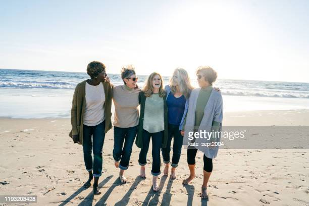 walking support group for women in their 60s - kate green stock pictures, royalty-free photos & images