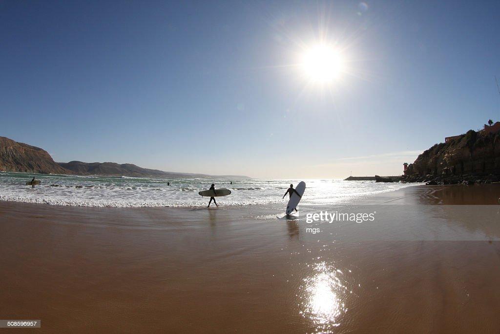 Walking surfer : Stock Photo