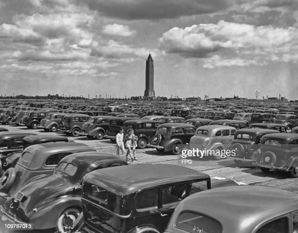 Walking through a parking lot in Jones Beach Long Island in the 1940's