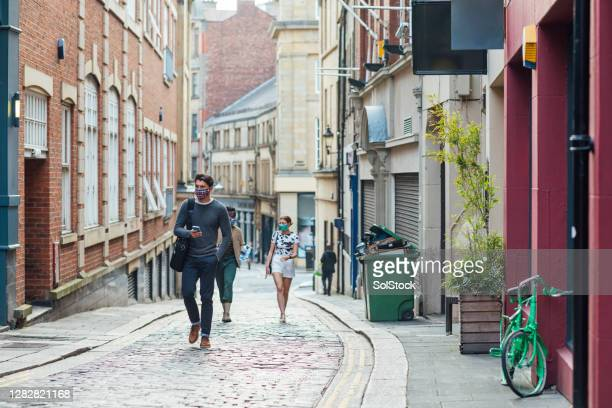 walking through a side street in town to uni - season 3 stock pictures, royalty-free photos & images