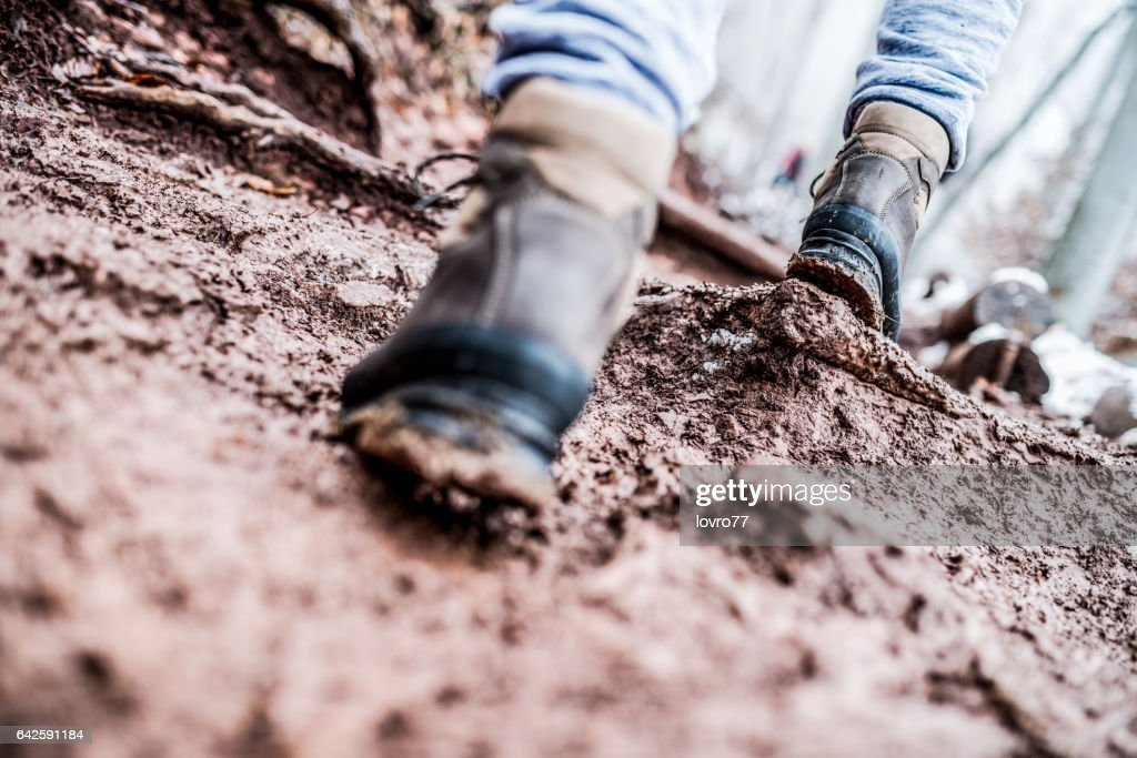 Walking through the mud : Stock Photo