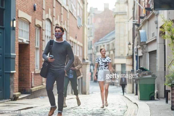 walking through town - season 3 stock pictures, royalty-free photos & images