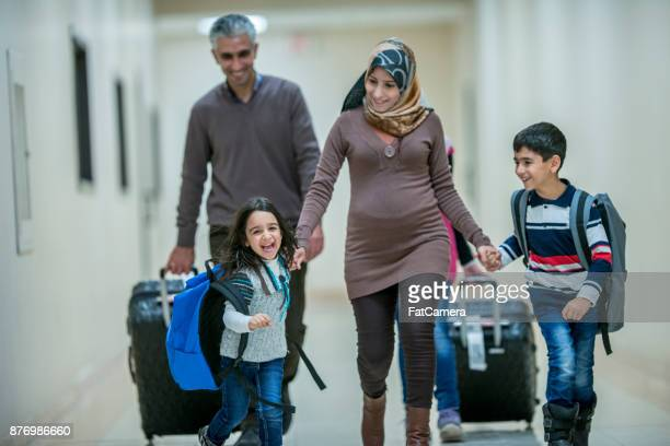 walking to a new home - emigration and immigration stock pictures, royalty-free photos & images